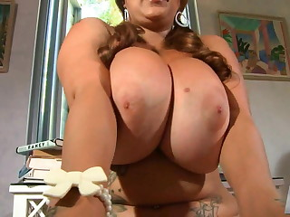 X partisan plays with her boobs an pussy